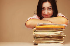 Exhausted beautiful business woman holding document folder Royalty Free Stock Photo