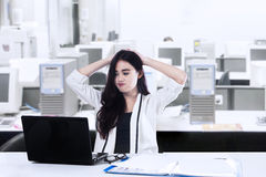 Exhausted Beautiful Businesswoman Stock Photography