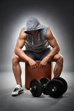 Exhausted bodybuilder with dumbbells Stock Photos