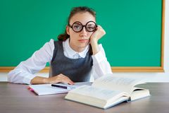 Exhausted or bored young student in classroom stock image