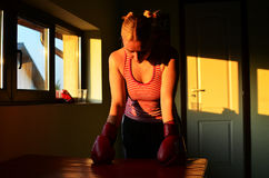 EXHAUSTED BOXING GIRL AFTER TRAINING SESSION Stock Photos