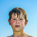 Exhausted boy after swimming at the beach Stock Photos