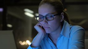 Exhausted business lady looking at computer screen, lack of energy, overwork stock footage