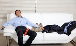 Exhausted business man Stock Images
