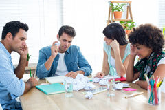 Exhausted business team making paper pellet Royalty Free Stock Photography