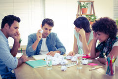 Exhausted business team making paper pellet royalty free stock image