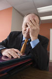 Exhausted businessman Stock Image
