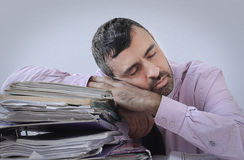 Exhausted businessman asleep at his desk Royalty Free Stock Image