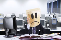 Exhausted businessman with cardboard head Stock Photos