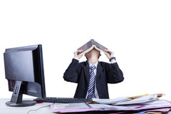 Exhausted businessman covering his face Royalty Free Stock Photos