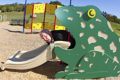 Exhausted Businessman in Frog Slide Stock Photo