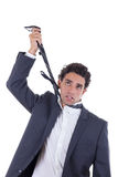 Exhausted businessman hanging himself on tie Royalty Free Stock Image