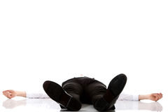 Exhausted businessman lying on the floor. Royalty Free Stock Photography