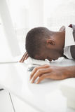 Exhausted businessman napping on keyboard Stock Photography