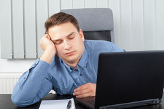 Exhausted businessman at the office Royalty Free Stock Photos
