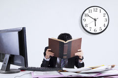 Exhausted businessman in office 2 Royalty Free Stock Images