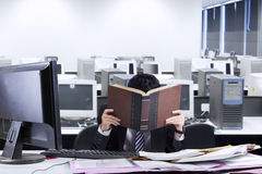 Exhausted businessman in office Royalty Free Stock Photo