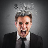 Exhausted businessman. Businessman screaming with springs jumping from head Stock Photos