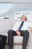 Exhausted businessman sleeping Stock Image