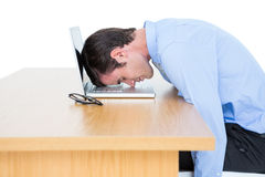 Exhausted businessman sleeping head on laptop Royalty Free Stock Photo