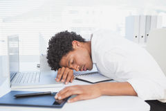 Exhausted businessman sleeping at his desk Stock Photo