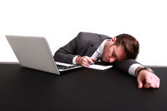 An exhausted businessman. Sleeping on his laptop Stock Images