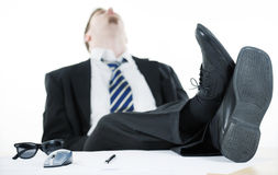Exhausted businessman. Sleeping in the office Royalty Free Stock Photography
