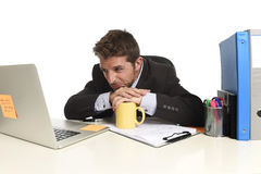 Exhausted businessman suffering stress at office computer desk overwhelmed tired Stock Images