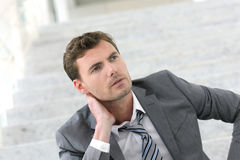 Exhausted businessman thinking about his future Stock Photo