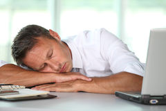 Exhausted businessman at work Stock Photography