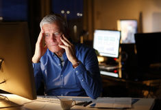 Exhausted businessman working late night Royalty Free Stock Photos