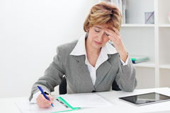 Exhausted businesswoman Royalty Free Stock Images
