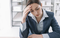 Exhausted businesswoman in the office Stock Photos