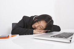 Exhausted businesswoman resting at office desk royalty free stock images