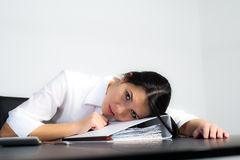 Exhausted businesswoman or student Stock Photography