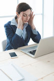 Exhausted businesswoman at work Royalty Free Stock Photography