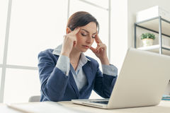 Exhausted businesswoman at work Royalty Free Stock Image