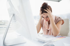 Exhausted businesswoman working with colour sample Royalty Free Stock Photography