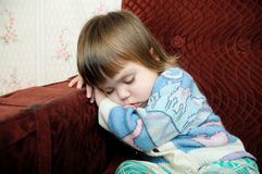 Exhausted child sleeping on chair, tired kid fall asleep Stock Images