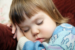 Exhausted child sleeping portrait on chair closeup, tired kid fall asleep. After playing Royalty Free Stock Photos
