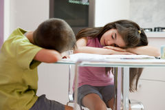 Exhausted children studying Stock Image