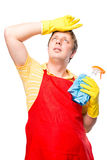 Exhausted from cleaning the house of a man housewife Royalty Free Stock Image
