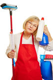 Exhausted cleaning lady with cleaning supplies Stock Photos