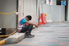 Exhausted Construction Worker Takes a Break in Singapore Royalty Free Stock Images