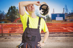 Exhausted construction worker stock photo