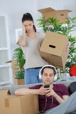 Exhausted couple taking break from packing. Exhausted couple taking a break from packing Stock Photography