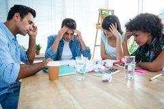Exhausted creative business team riled up Stock Image