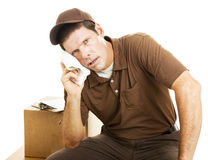 Exhausted Delivery Guy Royalty Free Stock Photo