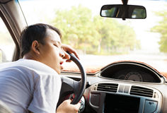 Exhausted driver resting on steering wheel. In the car Royalty Free Stock Photo