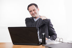 Exhausted employee with neck pain Stock Image